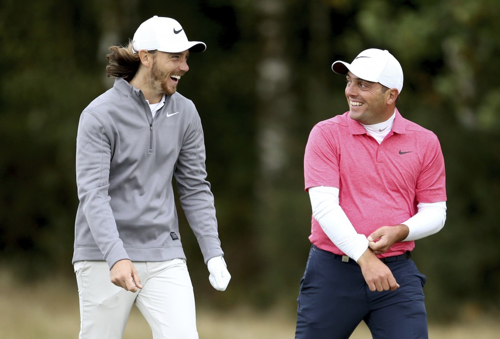 England's Tommy Fleetwood, left, and Italy's Francesco Molinari chat during day two of the British Masters at Walton Heath Golf Club, Surrey, Enland,