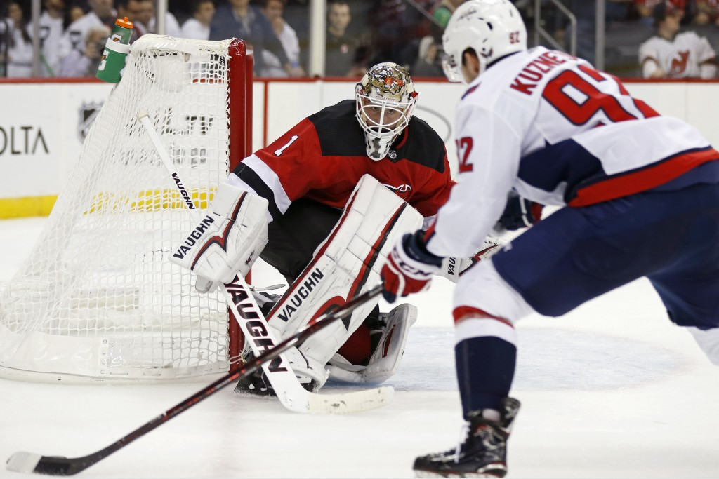 New Jersey Devils goaltender Keith Kinkaid (1) defends against Washington Capitals center Evgeny Kuznetsov (92) during the third period of an NHL hock