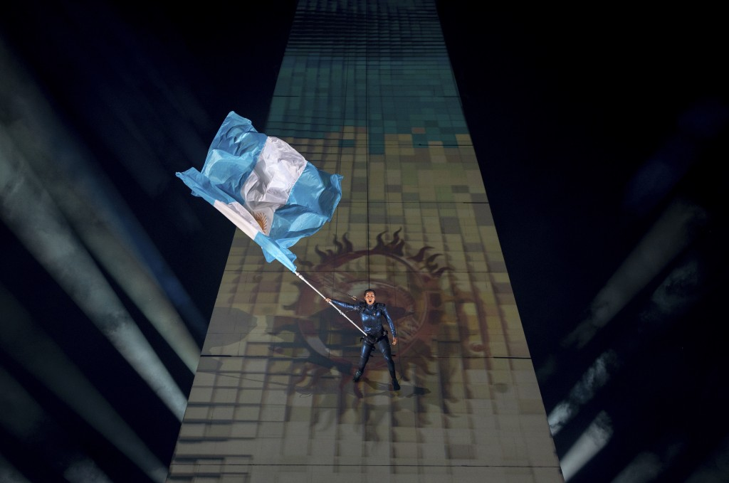 In this Saturday, Oct. 6, 2018 photo, the Argentine national flag is walked by a performer down the Obelisk of Buenos Aires at the start of the Youth