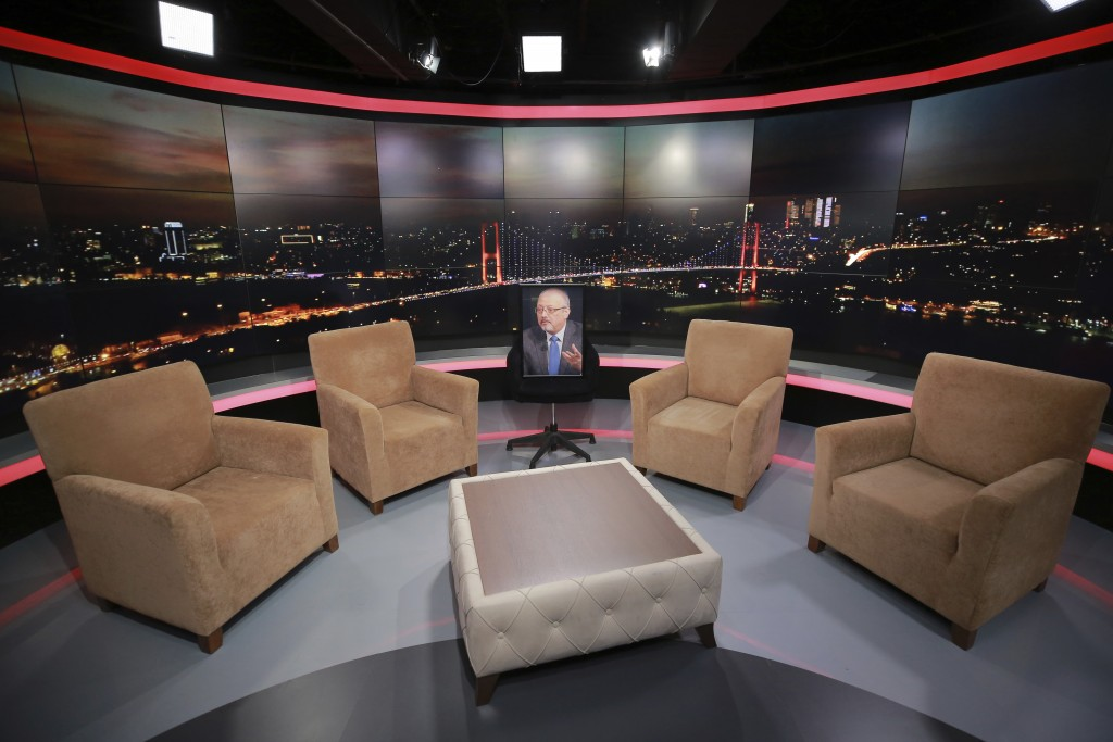An empty chair with a picture of Saudi writer Jamal Khashoggi placed on it is seen before a live television program for London-based TV station al-Hew
