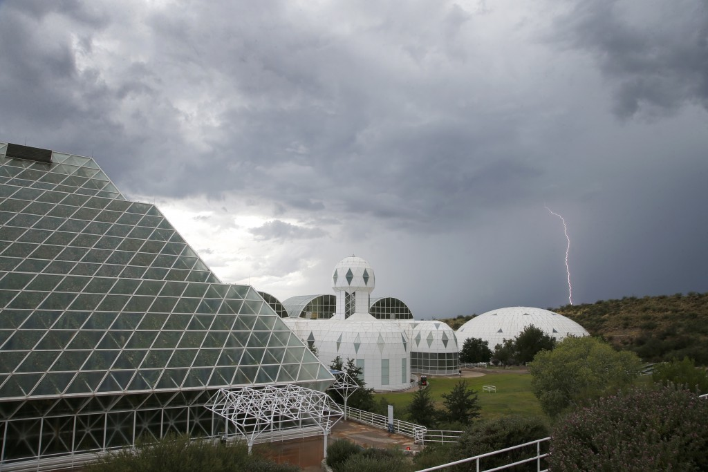 In this July 31, 2015 photo, several of the main buildings of the Biosphere 2 complex, including the tropical rainforest, left, the technosphere, midd