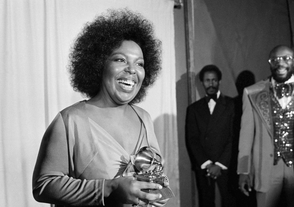 "FILE - In this March 4, 1974 file photo, Roberta Flack holds the Grammy award for her record, ""Killing Me Softly With His Song"" as singer Isaac Hayes,"