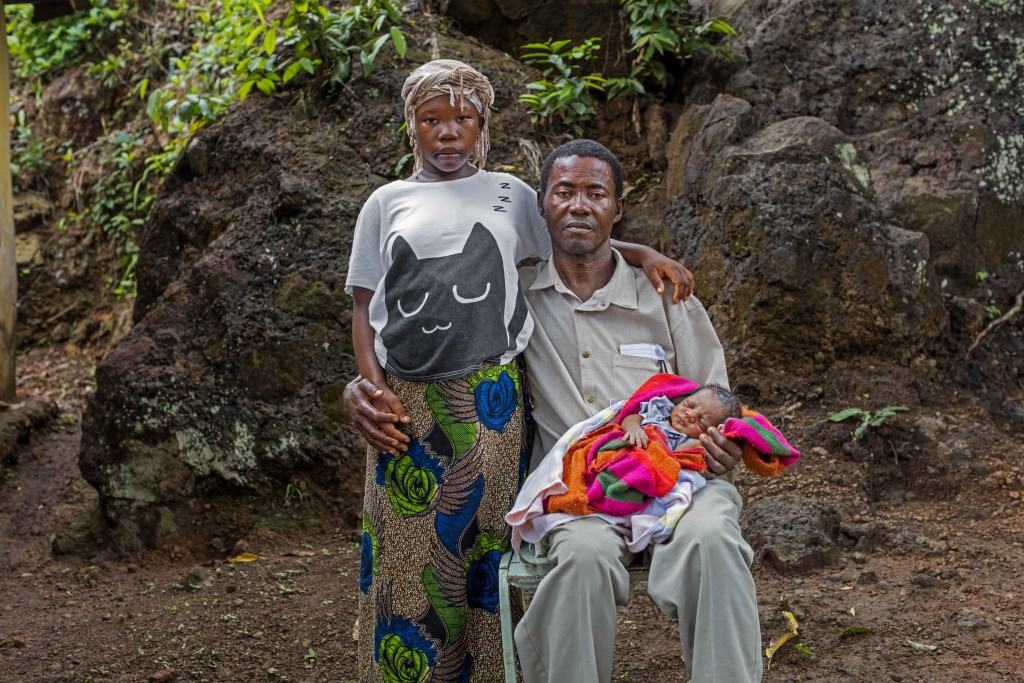 In this photo taken in 2016, Baby Seibureh, 17, and Claude Seibureh, 48, of Freetown, were married during the Ebola crisis. Because of her small statu