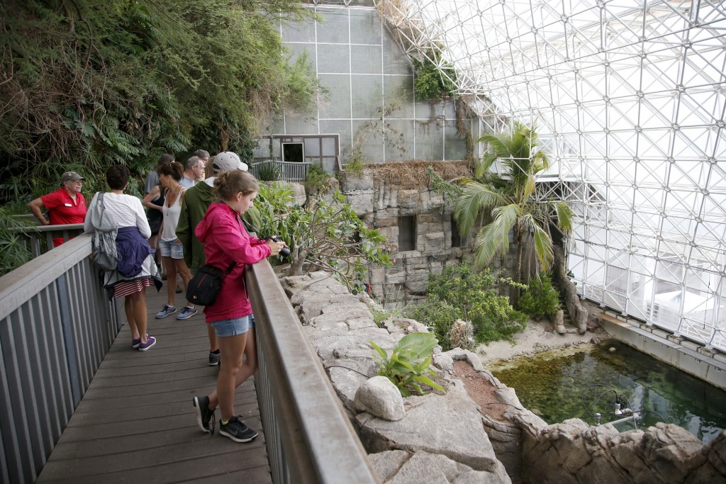 In this July 31, 2015 photo, tourists check out the Biosphere 2 Ocean, holding a million gallons of seawater, designed as an enclosed ecological syste