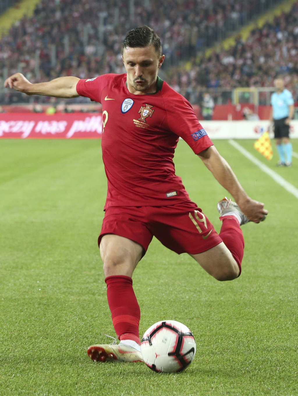 Portugal's Mario Rui passes the ball during the UEFA Nations League soccer match between Poland and Portugal at the Silesian Stadium Chorzow, Poland,