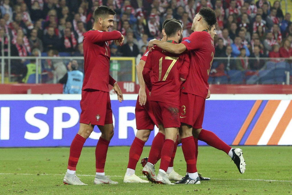 Portuguese players celebrate scoring their side's second goal during the UEFA Nations League soccer match between Poland and Portugal at the Silesian