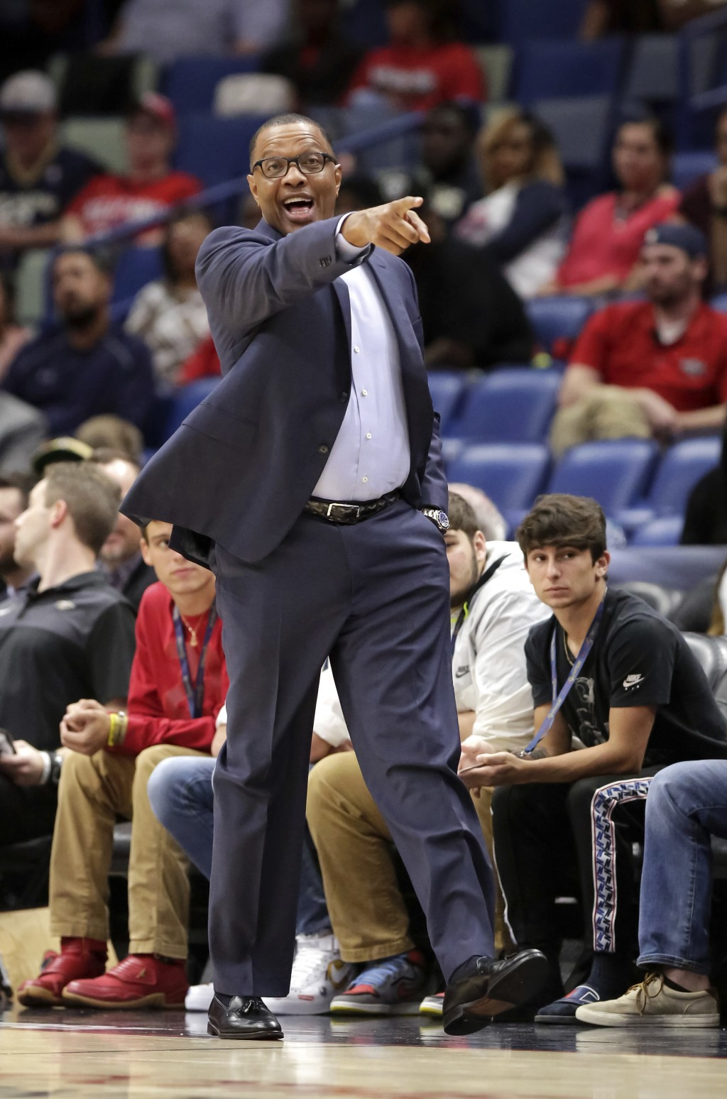 New Orleans Pelicans coach Alvin Gentry yells to his players during the first half of a preseason NBA basketball game against the Toronto Raptors in N