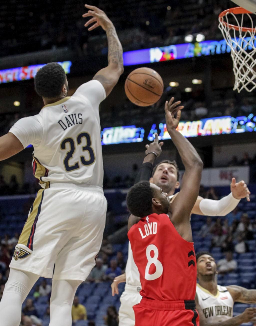 New Orleans Pelicans forward Anthony Davis (23) blocks a shot by Toronto Raptors guard Jordan Loyd (8) during the first half of a preseason NBA basket