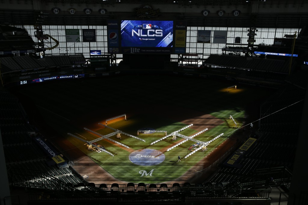 Workers get Miller Park ready for Game 1 of the National League Championship Series baseball game Thursday, Oct. 11, 2018, in Milwaukee. The Milwaukee