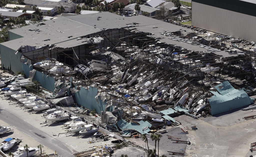 A roof over a boat storage building is collapsed following Hurricane Michael Thursday, Oct. 11, 2018, in Panama City Beach, Fla. Hurricane Michael mad