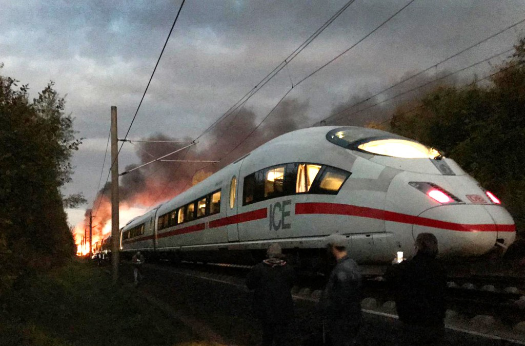 Flames and smoke rise over an ICE train near Montabaur, western Germany, Friday morning, Oct. 12, 2018. Nobody was injured when the high-speed train w