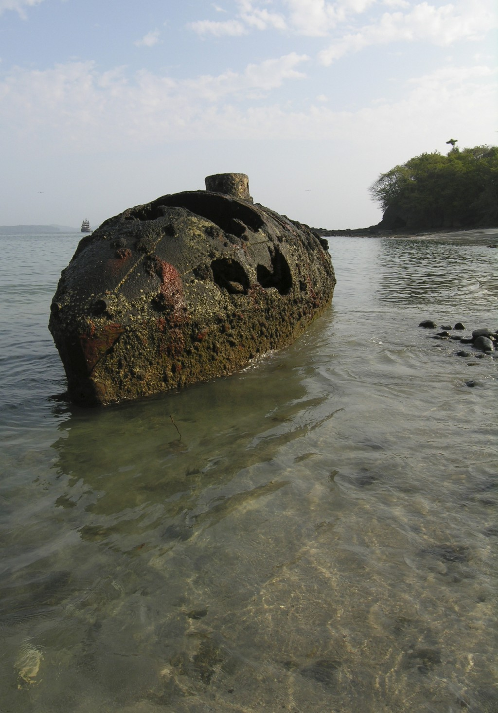 In this March 12, 2004 photo provided by the U.S. embassy in Panama, the submarine designed by Julius H. Kroehl emerges from the water during low tide
