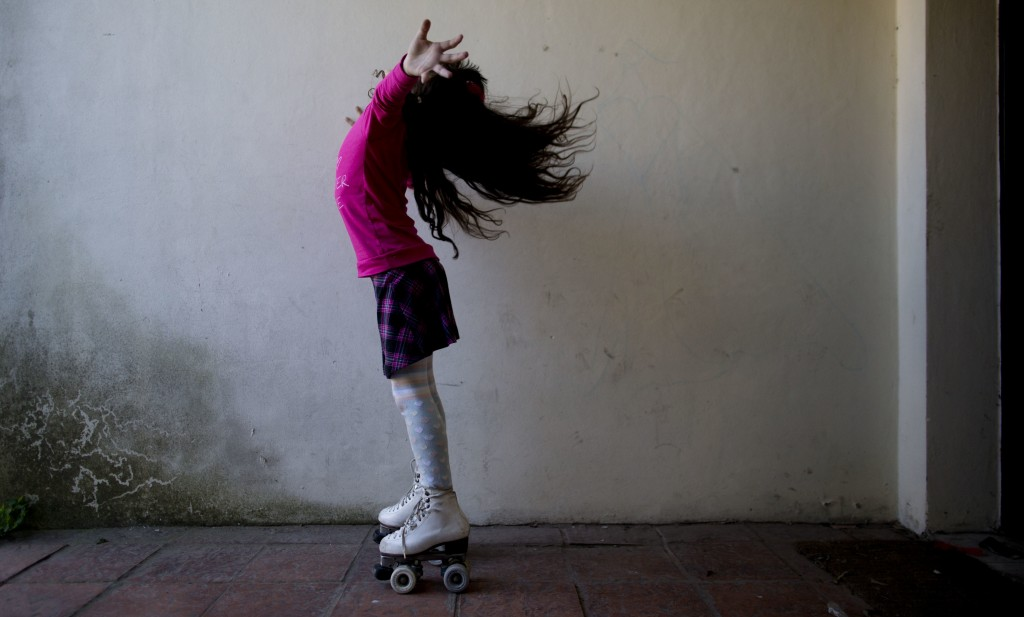 FILE - In this Sept. 29, 2015, file photo, Luana poses for photos on her roller skates at her home in Merlo, Argentina. Luana says that when one of th
