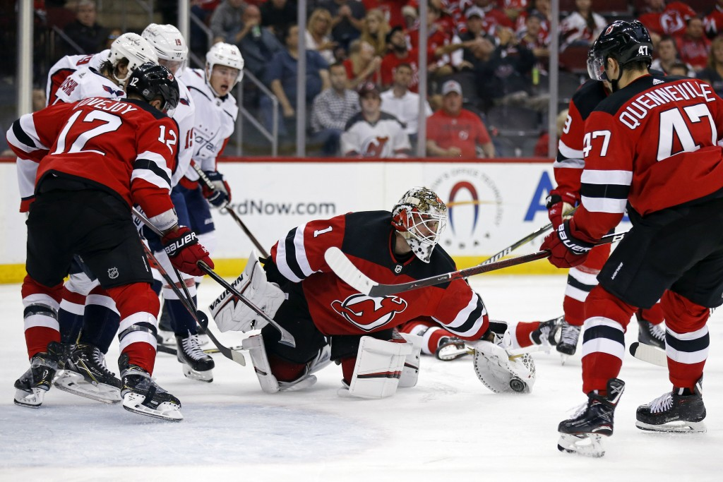 New Jersey Devils goaltender Keith Kinkaid (1) makes a save against the Washington Capitals during the third period of an NHL hockey game Thursday, Oc
