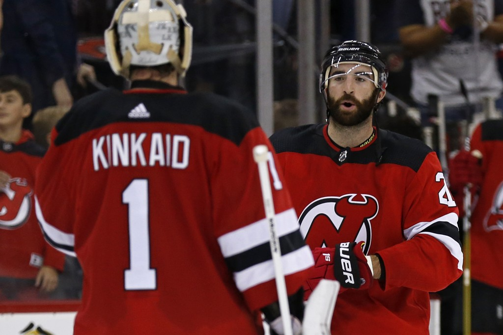 New Jersey Devils right wing Kyle Palmieri celebrates with goaltender Keith Kinkaid (1) after the Devils defeated the Washington Capitals 6-0 in an NH