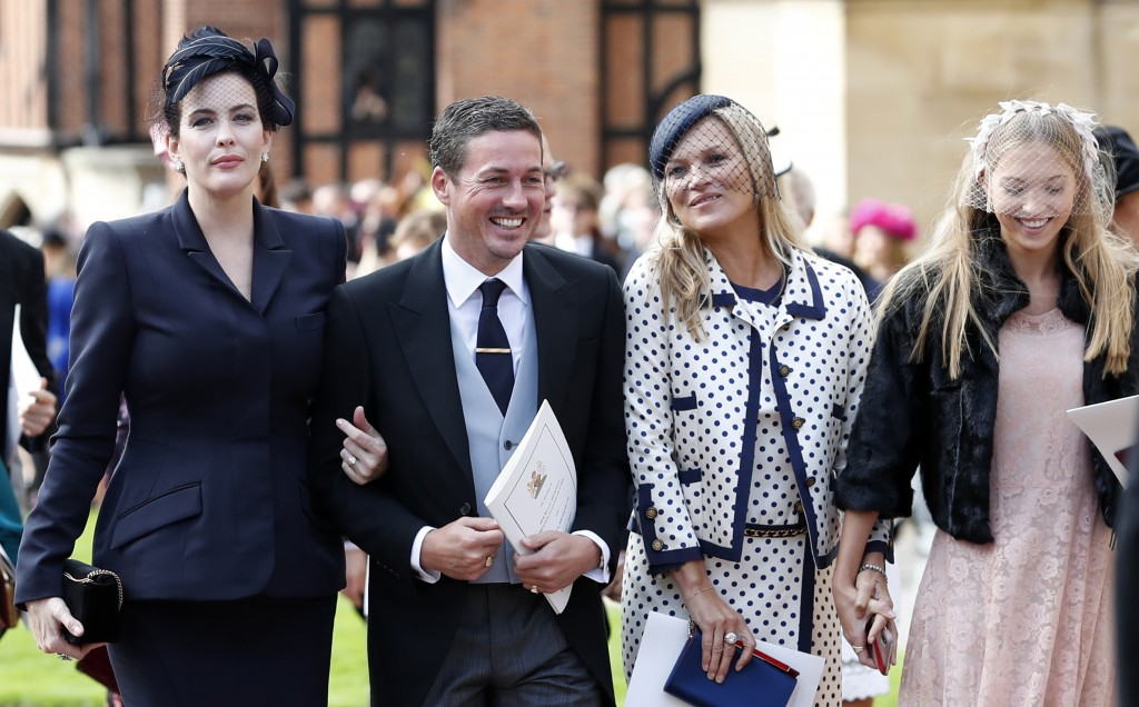 From left, US actress Liv Tyler, her husband Dave Gardner, Kate Moss and her daughter Lila attend the wedding of Princess Eugenie of York and Jack Bro
