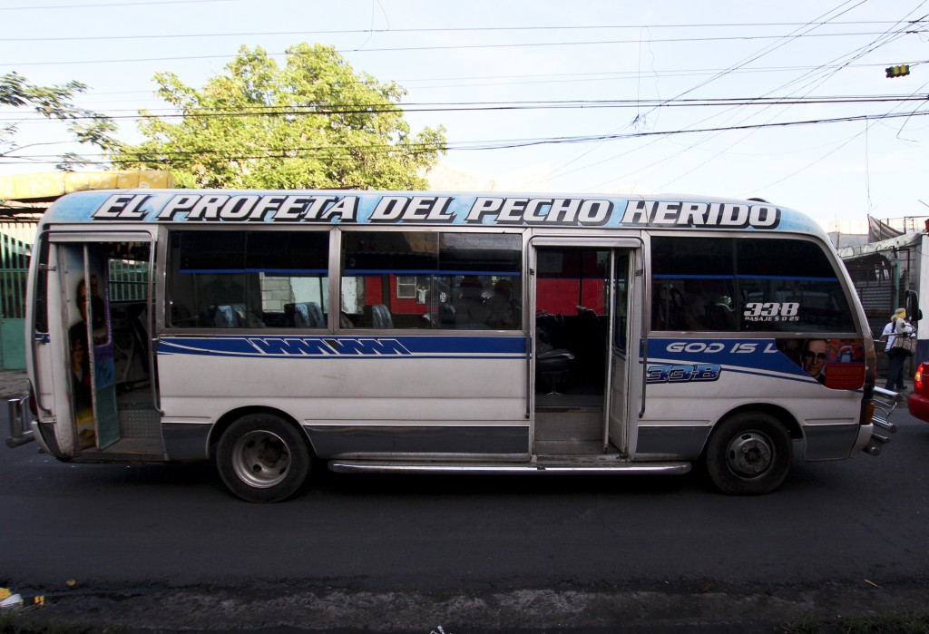 "In this Aug. 2. 2018 photo, a mini-bus with the phrase in Spanish ""The prophet of the wounded chest"", drives on a street in San Salvador, El Salvador."