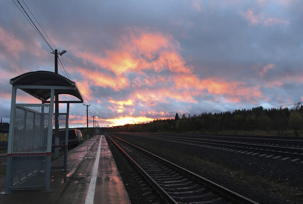 The sun sets at the train station in the village of Loyga, northern Russia, Wednesday Oct. 10, 2018. The career trajectories of suspected Russian mili