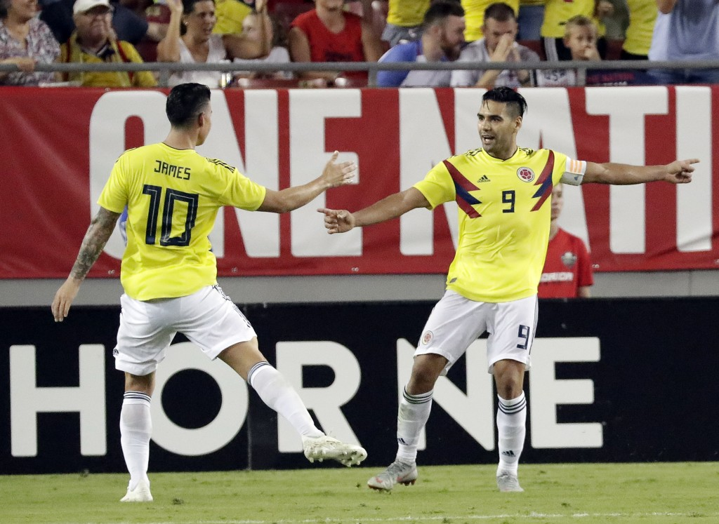 Colombia's Radamel Falcao (9) celebrates his goal against the United States with teammate James Rodriguez (10) during the second half of an internatio