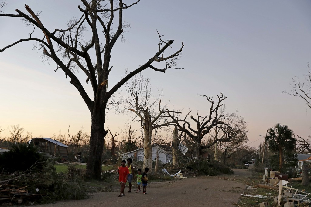 Barren trees line a street damaged by hurricane Michael in Springfield, Fla., Thursday, Oct. 11, 2018. The devastation inflicted by Hurricane Michael