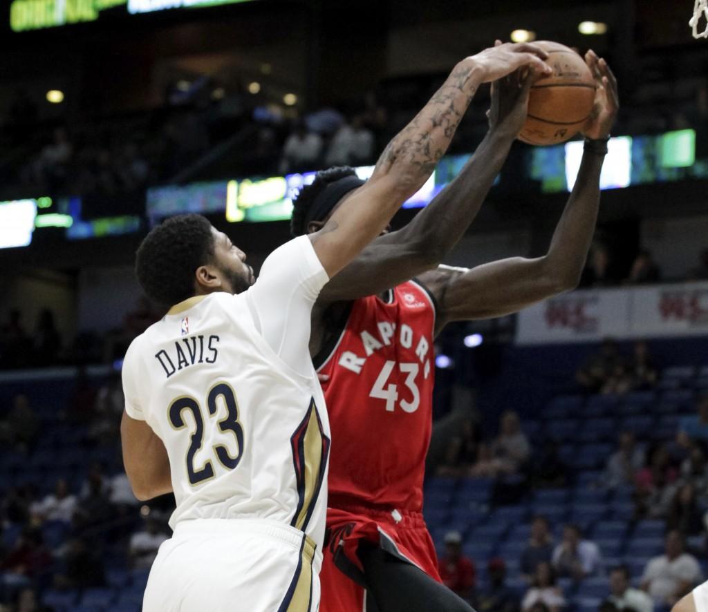 New Orleans Pelicans forward Anthony Davis (23) blocks a shot by Toronto Raptors forward Pascal Siakam (43) during the first half of a preseason NBA b