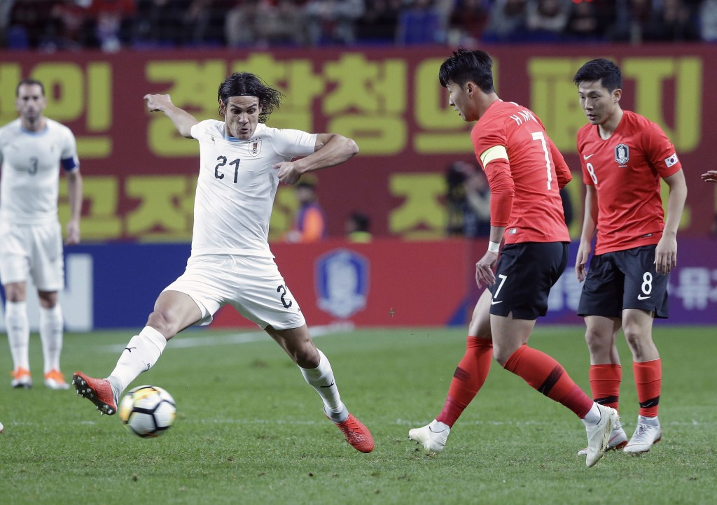 South Korea's Son Heung-min, second from right, fights for the ball against Uruguay's Edinson Cavani, left, during their friendly soccer match in Seou