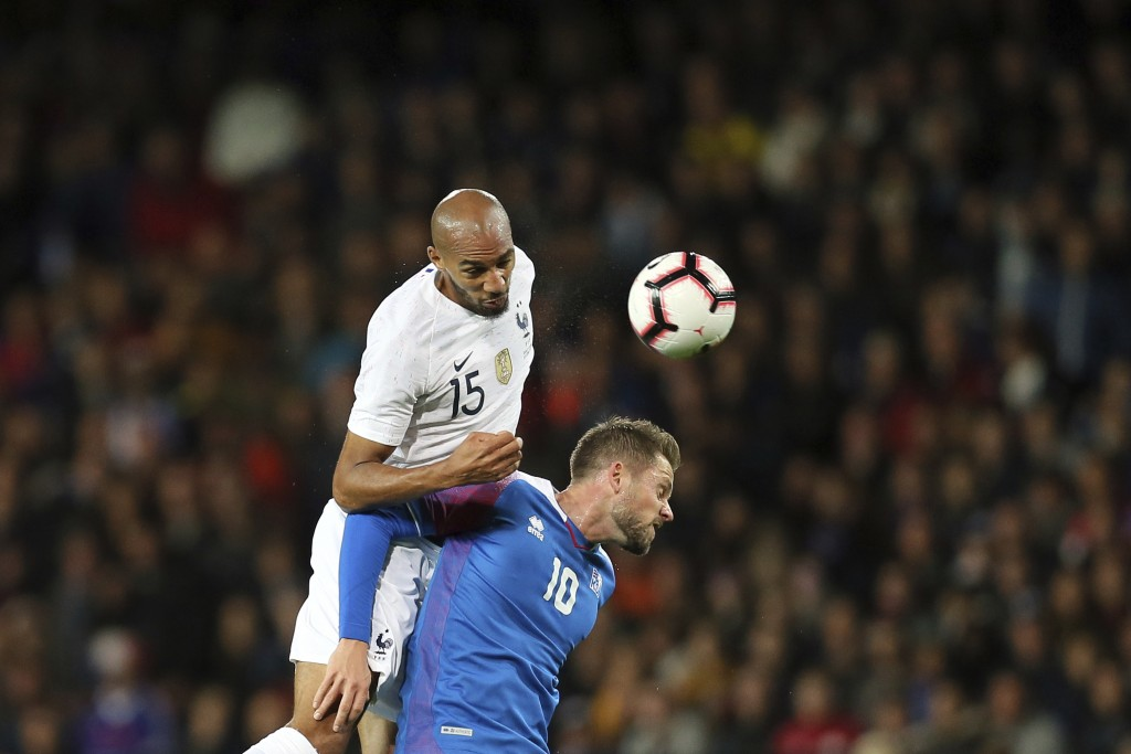 France's Steven Nzonzi, left, and Iceland's Gylfi Sigurdsson, challenge to head the ball during a friendly soccer match between France and Iceland, in