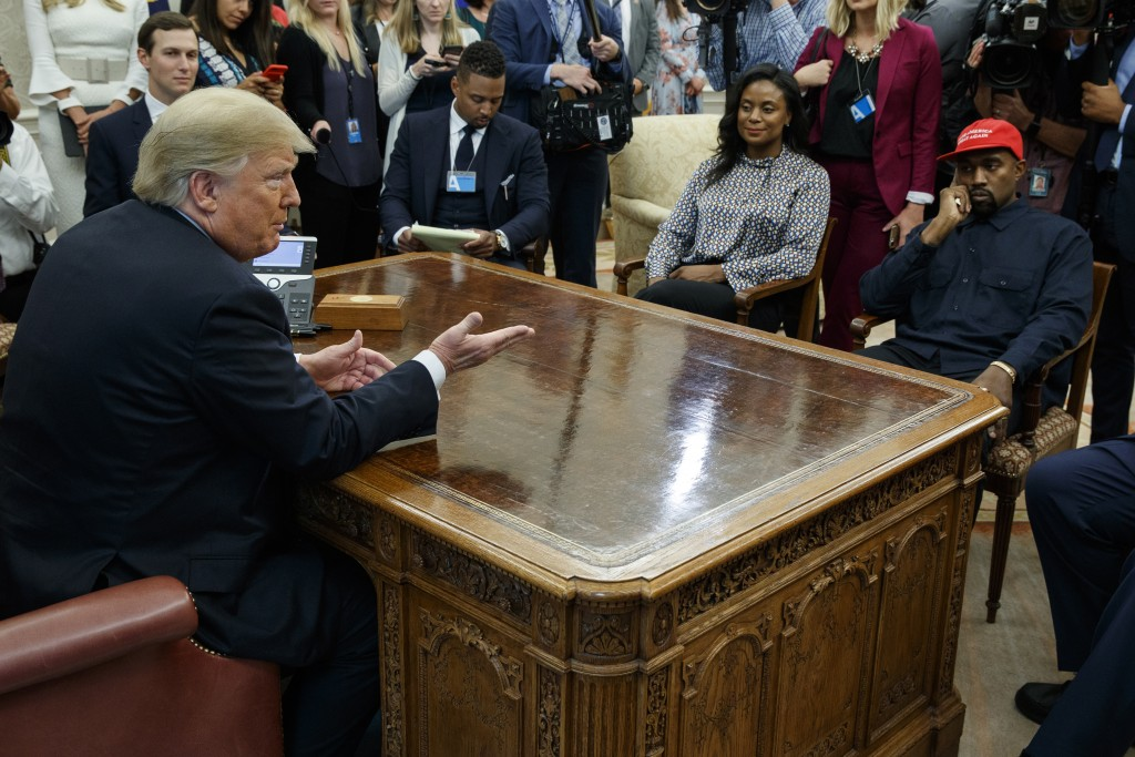 President Donald Trump meets with rapper Kanye West in the Oval Office of the White House, Thursday, Oct. 11, 2018, in Washington.  At left is White H