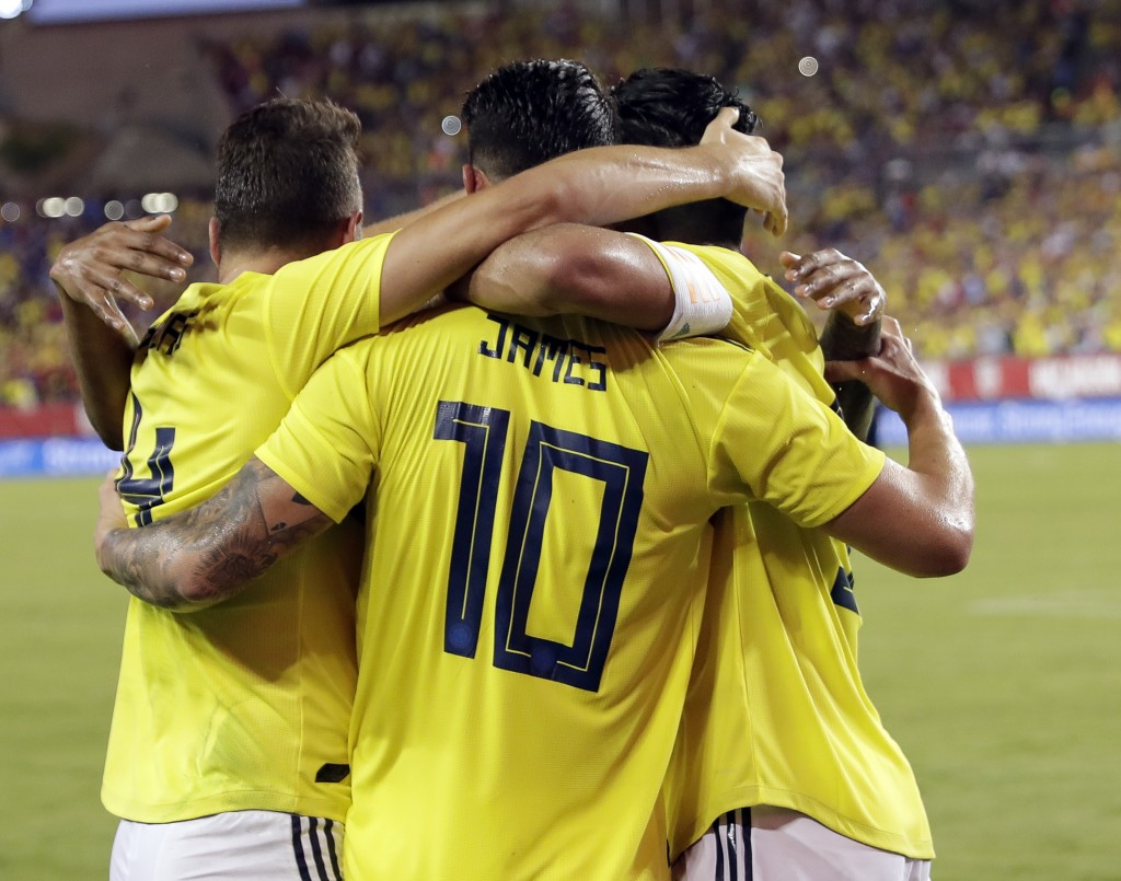Colombia's James Rodriguez (10) celebrates his goal against the United States with teammates during the first half of an international friendly soccer