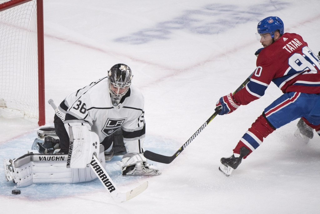 Los Angeles Kings goaltender Jack Campbell makes a save against Montreal Canadiens' Tomas Tatar during the first period of an NHL hockey game Thursday