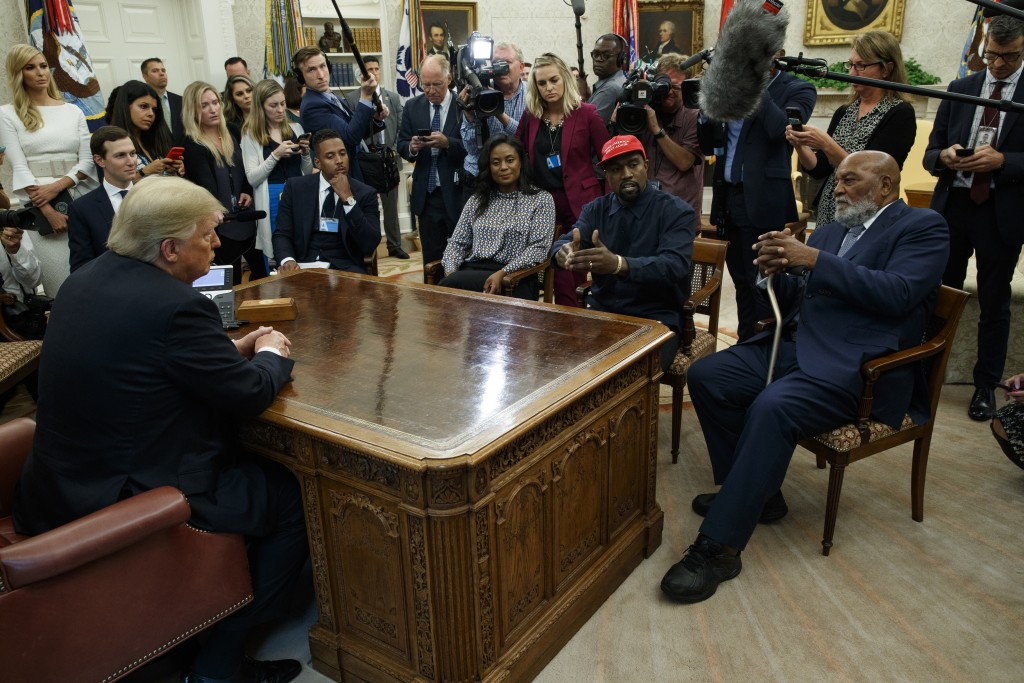 President Donald Trump meets with musician Kanye West and former football player Jim Brown in the Oval Office of the White House, Thursday, Oct. 11, 2