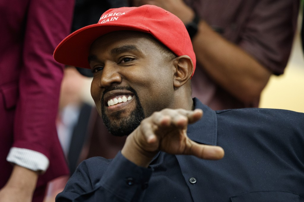 Rapper Kanye West smiles as he talks with President Donald Trump during a meeting in the Oval Office of the White House, Thursday, Oct. 11, 2018, in W