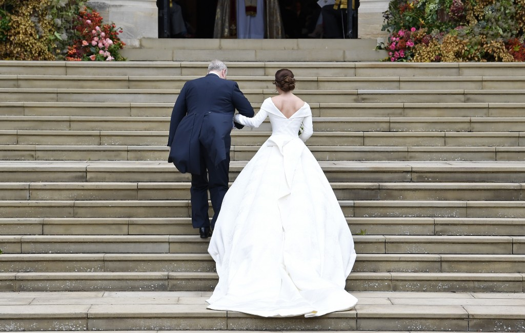 Britain's Princess Eugenie, accompanied by her father Prince Andrew, arrives for her wedding ceremony to Jack Brooksbank in St George's Chapel, Windso