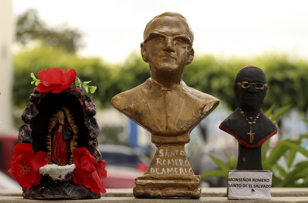 In this Oct. 7. 2018 photo, small handmade busts of Archbishop Oscar Arnulfo Romero are sold outside the Metropolitan Cathedral in San Salvador, El Sa