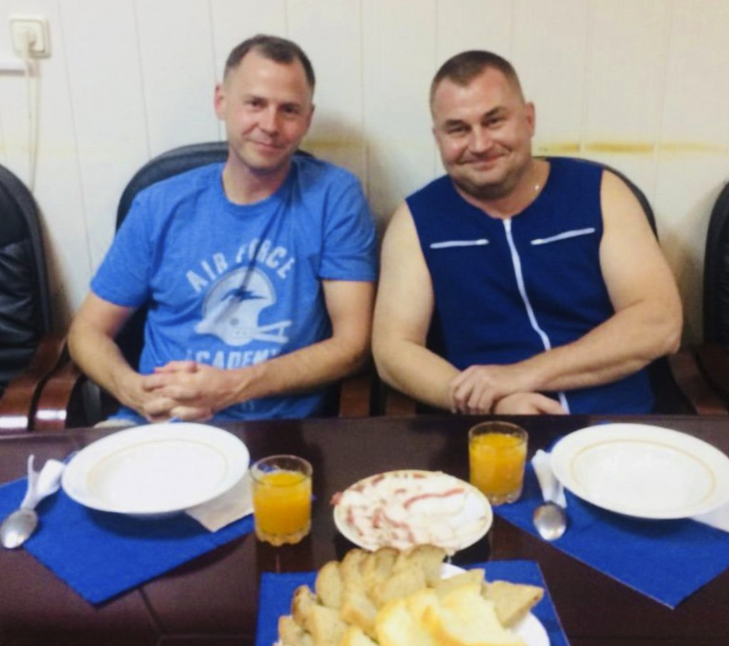 In this photo released by Roscosmos, NASA Astronaut Nick Hague, left, and Roscosmos cosmonaut Alexei Ovchinin pose for a photo in Baikonur, Kazakhstan