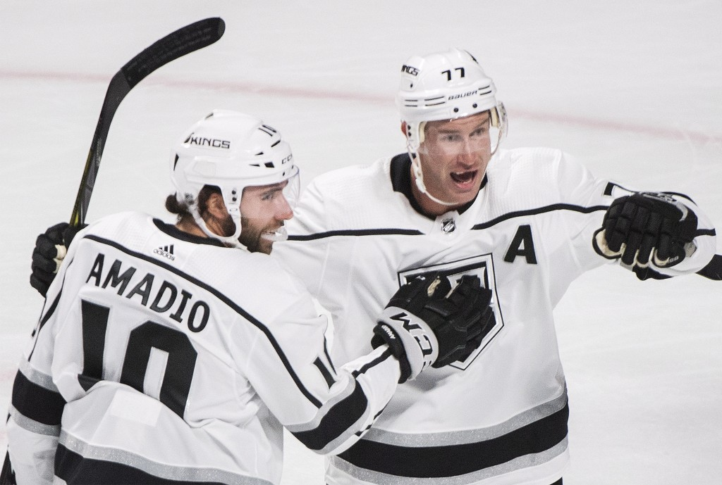 Los Angeles Kings' Michael Amadio, left, celebrates with Jeff Carter (77) after scoring against the Montreal Canadiens during the first period of an N