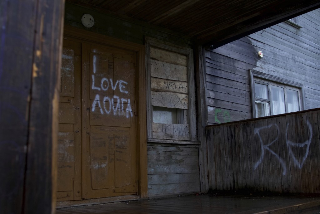 """I love Loyga"" is spray-painted on the door of an abandoned house in the village of Loyga, northern Russia, Wednesday Oct. 10, 2018. The career trajec"