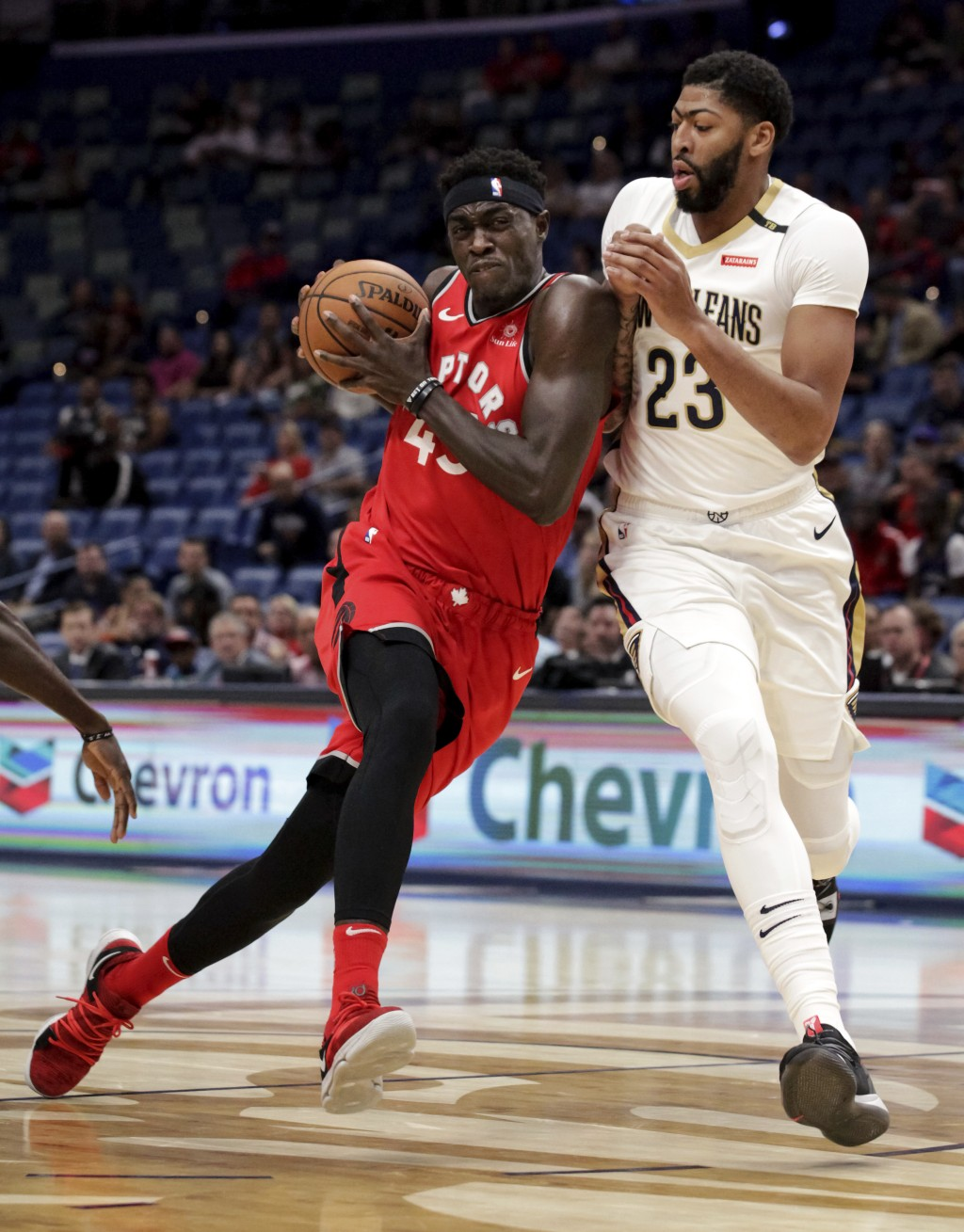 Toronto Raptors forward Pascal Siakam (43) drives against New Orleans Pelicans forward Anthony Davis (23) during the first half of a preseason NBA bas