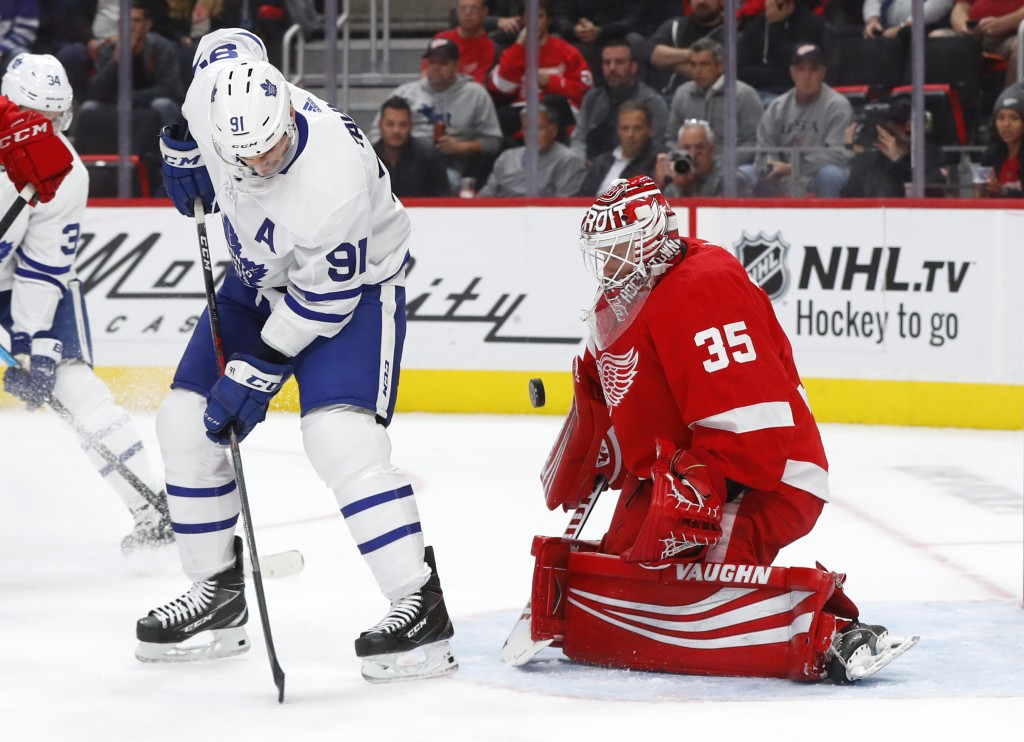 Detroit Red Wings goaltender Jimmy Howard (35) stops a deflection by Toronto Maple Leafs center John Tavares (91) during the first period of an NHL ho