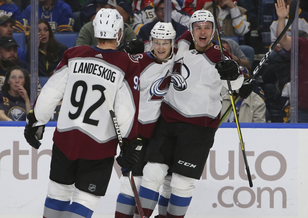 Colorado Avalanche forward Nathan MacKinnon (29) celebrates his goal with teammates Gabriel Landeskog (92) and Vladislav Kamenev (91) during the secon