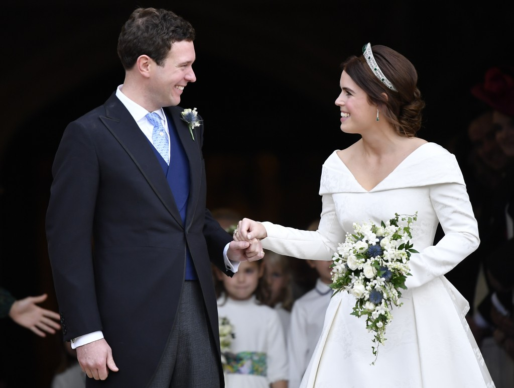 Britain's Princess Eugenie and Jack Brooksbank leave St George's Chapel after their wedding at Windsor Castle, near London, England, Friday Oct. 12, 2
