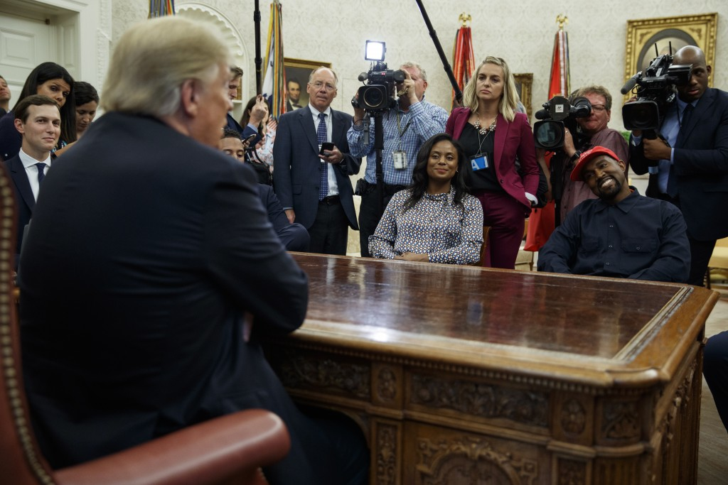 President Donald Trump meets with rapper Kanye West and Hall of Fame football player Jim Brown in the Oval Office of the White House, Thursday, Oct. 1