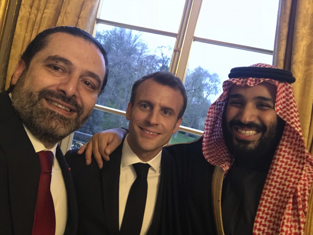 FILE - This photo released on the official twitter page of Lebanese Prime Minister Saad Hariri on Monday, April 9, 2018, shows Hariri, left, taking a