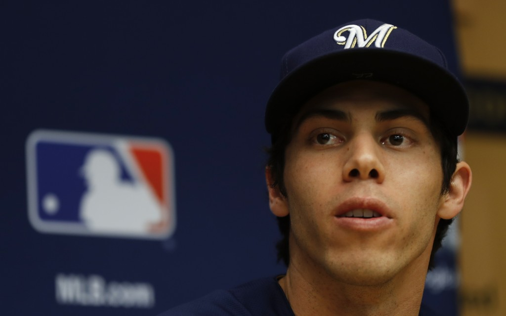 Milwaukee Brewers' Christian Yelich answers questions before Game 1 of the National League Championship Series baseball game Thursday, Oct. 11, 2018,