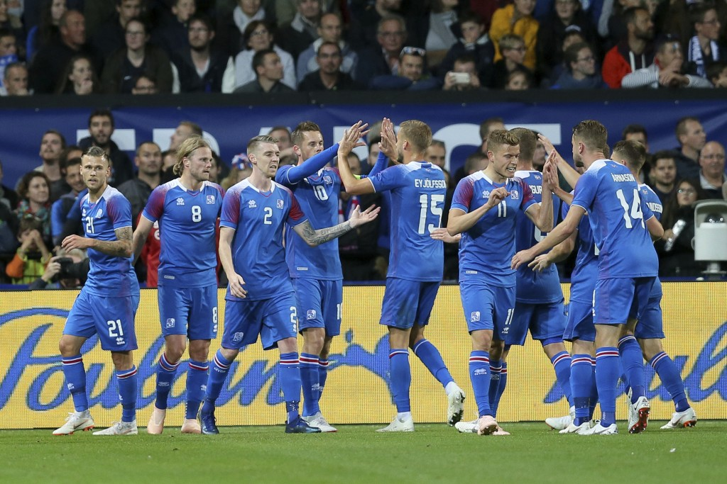 Iceland's players celebrate after Iceland's Birkir Bjarnason, second from left, scored a goal during a friendly soccer match between France and Icelan