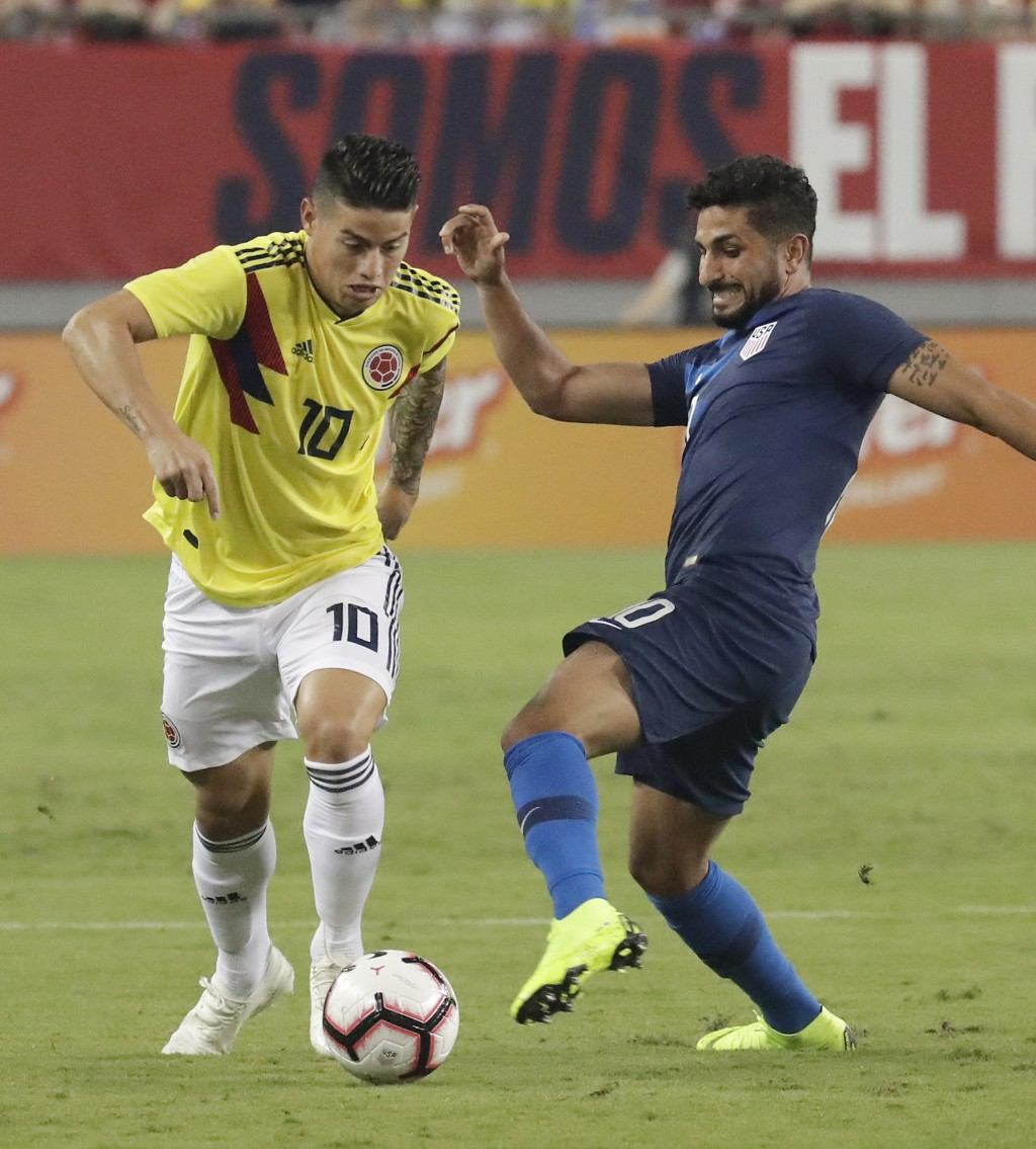 Colombia's James Rodriguez (10) moves the ball past Unites States' Kenny Saief during the first half of an international friendly soccer match Thursda