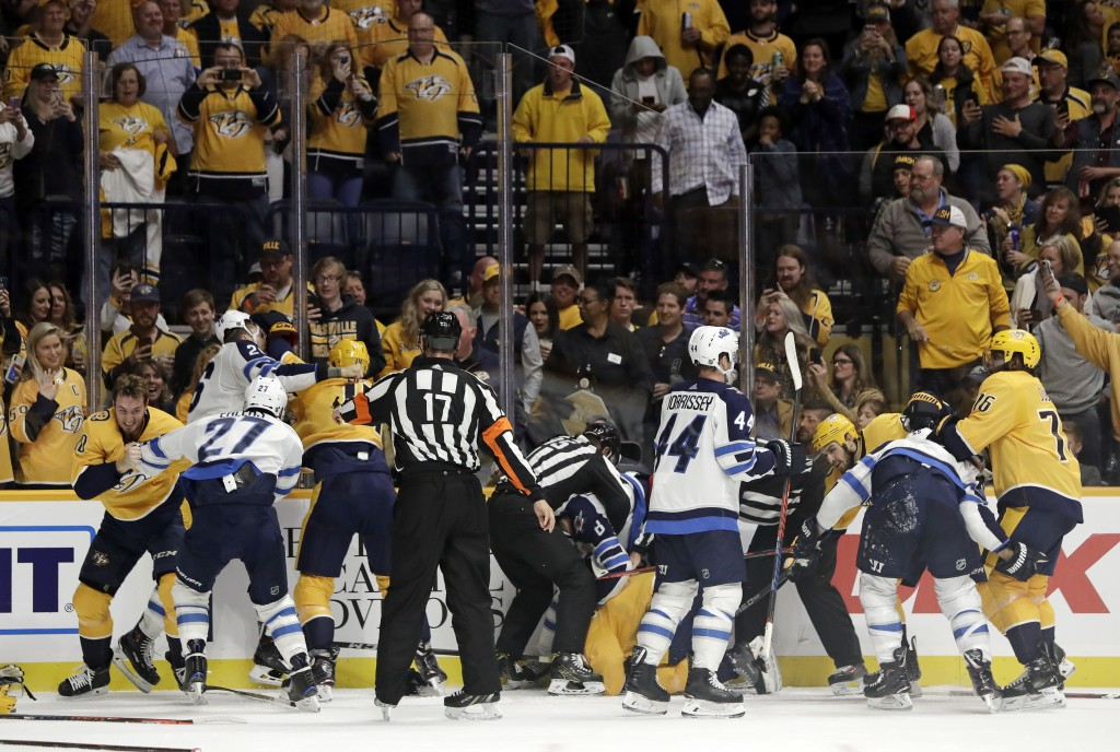 Several fights go on at once during the second period of an NHL hockey game between the Nashville Predators and the Winnipeg Jets on Thursday, Oct. 11