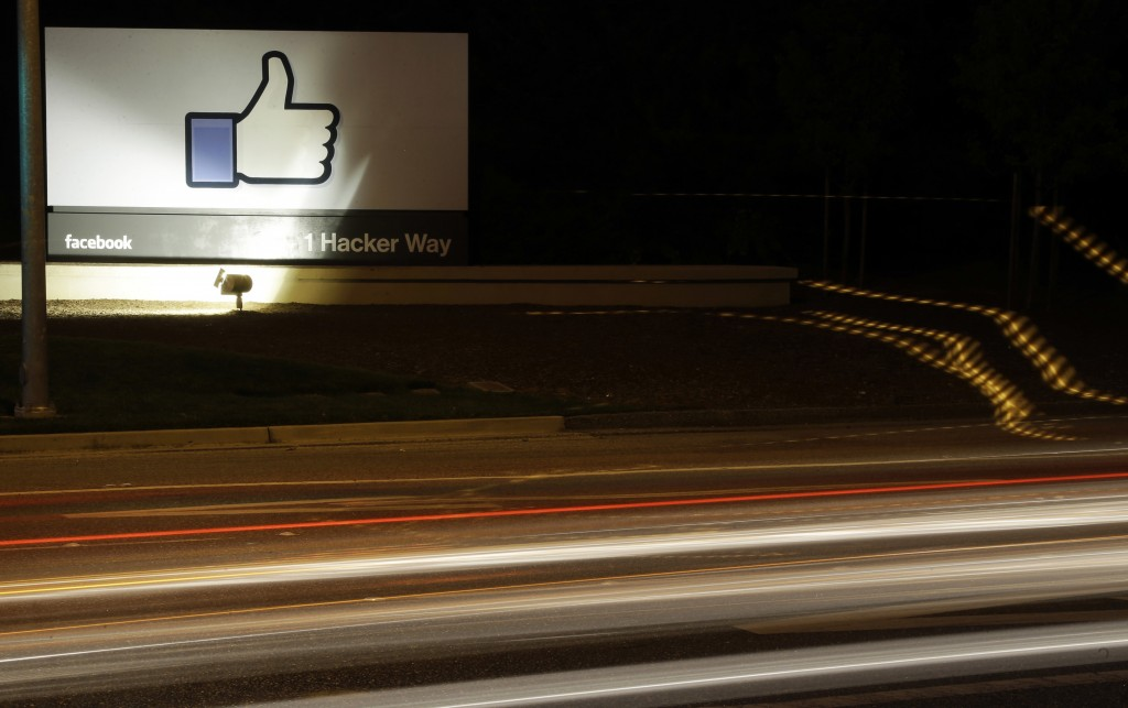 "FILE - In this June 7, 2013, file photo, the Facebook ""like"" symbol is on display on a sign outside the company's headquarters in Menlo Park, Calif. F"