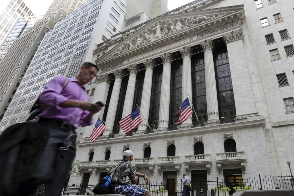 FILE - In this June 24, 2016, file photo, a man walks by the New York Stock Exchange. The U.S. stock market opens at 9:30 a.m. EDT on Friday, Oct. 12,