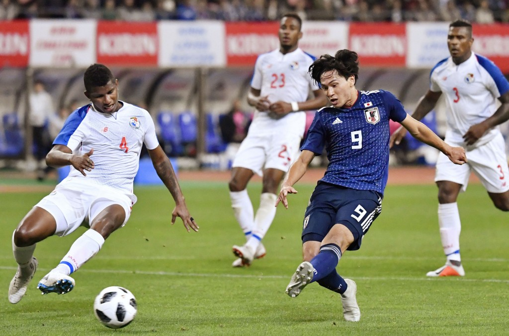Japan's Takumi Minamino, front right, scores a goal during the first half of their Kirin Challenge Cup soccer match against Panama in Niigata, Niigata